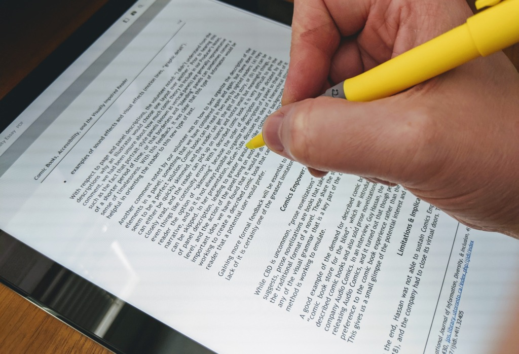 Photograph of physical highlighter over a tablet screen.